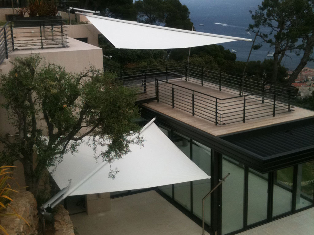 Install An Awning Thats Retractable With A Triangle Shade Sail From Artesun